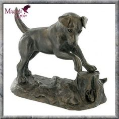 Jack Russell Cold Cast Bronze Dog Sculpture by Harriet Glen. One of our most popular cold cast bronze sculptures by world renown artist, Harriet Glenn. A cheeky Jack Russell has discovered something hiding under a tree stump! Stands at 12cm high.