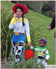 sandra bullock and louis in matching toy story costumes... i love her even more now!!!! awesome mom
