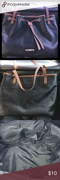 Nine West Tote Beautiful nice size Tote. Inside is exceptionally clean. No sign of wear. Straps and exterior of bag are in great condition. Dark black color with brown trim. Nine West Bags Totes