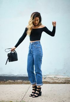 Reinvent high-waist, mom jeans with @stylecaster's street style round-up | 'Little Black Boots' blogger in black crop top, medium-wash denim