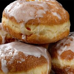 Bavarian cream (vanilla pudding) filled donuts dusted with powdered sugar or strawberry filled.