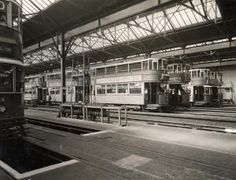 Interior of Camberwell LT tram depot (later Walworth bus garage). A number of E/1-class trams are drawn-up in the stabling roads. A plough rack stands in mid-ground centre. Photographed by Topical Press, 20 Aug 1936. Photograph 1998/87751 - Photographic collection, London Transport Museum