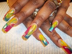 Tropical Island Nails  Freehand design done with OPI polish and rhinestones added.   Raleigh, NC