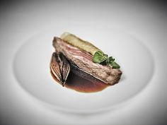 Bavette of beef with roasted shallot, watercress and beef jus