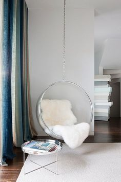 Wonderful Fabulous Bedroom Reading Corner Boasts A Hanging Acrylic Bubble Chair Lined  With A Sheepskin Pelt Next To A Round Silver Tray Table, Gaultier Side  Table, ...