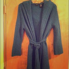 Long hooded sweater with belt Very cozy blue belted sweater with hood. The belt is removable. It's a warm sweater great for layering outside, or just lounging! I ordered it from Victoria's Secret online, and only wore it a few times. Moda International Sweaters