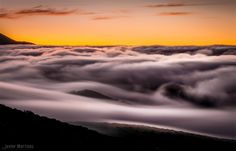 Islands - Sea of clouds on the Valle de la Orotava in Tenerife at dusk. Photography by Javier Martinez Moran