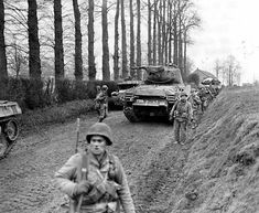 Infantrymen of the Division walk past Sherman tanks that have momentarily halted on a dirt road in Germany. This photo was taken in February and the war in Europe ended three months later. Ww2 Pictures, Ww2 Photos, Us Armor, Sherman Tank, Military Modelling, Ww2 Tanks, World War Two, Warfare, Wwii