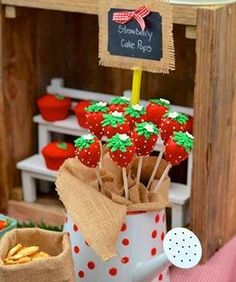 Strawberry cake pops decorated with burlap for a summer farmer's market inspired wedding.