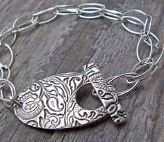 I like the idea of creating metal toggle clasps as focal point of wearable art creations.