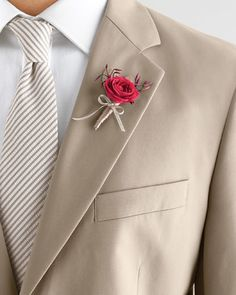 Even accessories can make a big statement when done right. This vibrant spray-rose boutonniere, accented with jasmine and millinery flowers and wrapped in ribbon, may be miniature but it won't be missed when set against a pale khaki jacket. Suit by Brooks Brothers. Shirt by Thomas Pink. Custom tie by Tiecrafters.