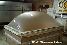 Transform an old domed skylight by digging a hole in a planting bed a few inches smaller than the skylight and put dirt to one side. Put your seed starts in the hole and cover with skylight. Water often and prop open on sunny days. Instant, green, cheap hot house! When seedlings are ready to plant refill hole and start again.