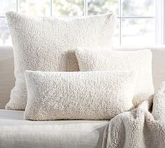 big square pillow + navy throw pillows on bed. Throw Pillows, Accent Pillows & Outdoor Throw Pillows | Pottery Barn