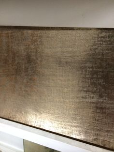 Linen textured bronze. Flexible metal coating suitable for wall and furniture treatment handmade by Stuart Fox in England