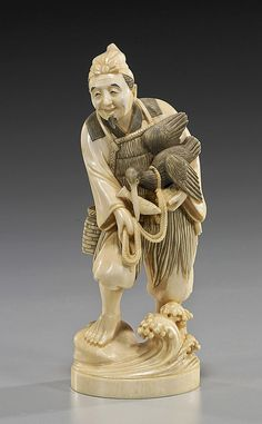 "Description: Antique Carved Ivory Okimono: Fisherman elaborately carved antique, Circa 1900, Japanese ivory okimono; of a cormorant fisherman, standing on rockery among waves and holding his bird with a fish in his beak, signed on red lacquer plaque; H: 7""; Provenance: the Estate of Zoltan Shaw, collected mid 20th Century"