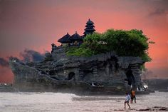 Tanah Lot is a rock formation of the Indonesian island of Bali. It is home of a pilgrimage temple, the Pura Tanah Lot, and a popular tourist and cultural icon for photography and general exoticism.