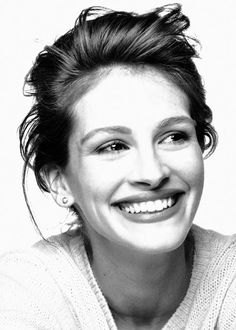 Julia Roberts she has litterally the most kindest most inviting smile anyone could have. Everything about her is beautiful! especially her laugh 1990's