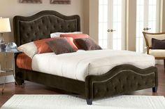 The Trieste bed is both fashionable and comfortable. An impressive, large headboard is complimented by nail-head trim and button and tuck styling. The fabric covered side rails and footboard continue the soft, luxurious theme. Available in your choice of three colors, the Trieste bed is a fantastic addition to any home. Fabric Color Choices: Buckwheat, Chocolate, and Pewter.