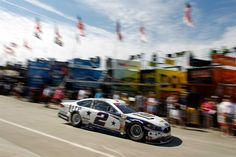 At-track photos: Saturday, Charlotte:   Saturday, May 28, 2016  -   CHARLOTTE, NC - MAY 28: Brad Keselowski, driver of the No. 2 Miller Lite Ford, passes through the garage area during practice for the NASCAR Sprint Cup Series Coca-Cola 600 at Charlotte Motor Speedway on May 28, 2016 in Charlotte, North Carolina.