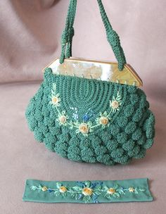 Vintage 1930's Crochet Handbag with Bakelite, Green, Blue, and Yellow Embroidered Flowers. $42.00, via Etsy.