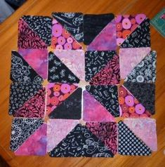 Half square triangle block 3,  See finished quilt.  7 of these blocks set on point plus extra Black HST complete the quilt.