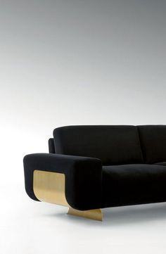 black and brass sofa