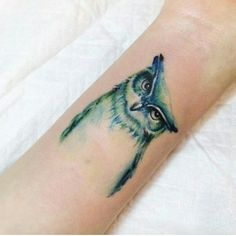Leading Tattoo Magazine & Database, Featuring best tattoo Designs & Ideas from around the world. At TattooViral we connects the worlds best tattoo artists and fans to find the Best Tattoo Designs, Quotes, Inspirations and Ideas for women, men and couples. White Owl Tattoo, Owl Eye Tattoo, Tattoo You, Owl Tattoos, Wrist Tattoo, Tattoo Designs And Meanings, Best Tattoo Designs, Dream Tattoos, Body Art Tattoos