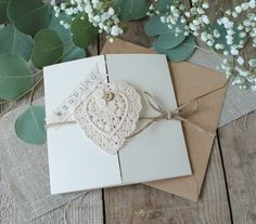 Pretty rustic wedding stationery with a crochet heart.