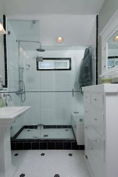 dual shower head fixture, glass shower door