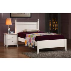 This white twin bed is the perfect way to get a good night's sleep in a small space. The hardwood frame is very sturdy, while the white finish and clean shape make it fit in with any room decor. This frame is designed to hold a twin mattress.