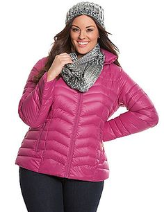 A warming trend for the fashionista on the go, our down-filled puffer jacket is as adorable as it is portable. Lightweight but ultra cozy, take the puffer trend where ever you go in the included drawstring bag that's small enough for your purse or glove box. Features a hidden drawstring hood in the snap-closure collar and zipped pockets. Zip-front closure. lanebryant.com