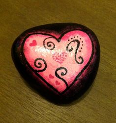 "Hand painted rock ""Pink Heart"". $15.00, via Etsy."