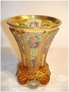 Bohemian amber glass pedestal vase/beaker with enamelled flowers and gold rim, c. 1900