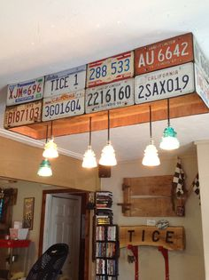 Barn wood and glass insulators from the family farm and license plates from both sides of the family and a perfect pool table light you now have