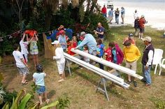 Here's how it works - boats are raced in a standard rain gutter that is ten feet long and filled to the top with water. The gutters are placed on saw horses. Boats are propelled by the kids blowing on the sail, either directly or through a drinking straw.