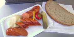 Bratwurst with spicy mustard, pickles, chilis and a slice of rye bread.....~Vienna, Austria ~2012