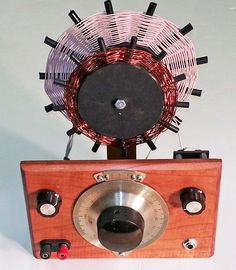 """It uses a very high Q Spider Coil. The coil is wound with 660/46 Litz and the Q is in excess of 1000, too high to measure on my HP 4342A Q Meter.  The radio has only one tuned circuit, the spider coil using a """"Holy Grail"""" silver and ceramic variable capacitor.  The antenna is coupled to the spider coil with the smaller non-resonant spider coil.  This coil does not resonate anywhere in the broadcast band, if it it did it would try to inject stations at its resonant point."""