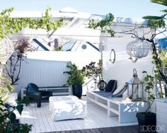 An outside terrace in Milan in the home Giampaolo Sgura and Miguel Arnau.  From Elle Decor.