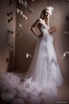 Elihav Sasson 2011 wedding dress - Dress with large pom pom style feather accents on the skirt and train.