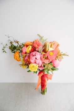 pink, yellow, orange colorful + whimsical bouquet | Photography: Larissa Cleveland