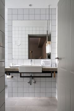 subway tile / industrial sink / pendant light / undersink toilet paper / Hotel SP34 / Copenhagen