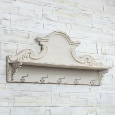 This distressed white wood shelf, featuring a carved wood crown molding back plate and shelf with five lower hooks, is sure to make a statement while adding vintage farmhouse to any space. White Wood Shelves, Wood Plank Shelves, Wood Floating Shelves, Diy Farmhouse Table, Antique Farmhouse, Farmhouse Style Decorating, French Farmhouse, Wall Shelf With Hooks, Wall Shelves