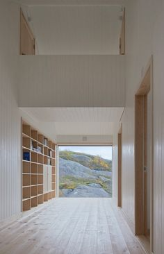 Minimalist Hallway with Shelving and Window from Vega Cottage in Norway