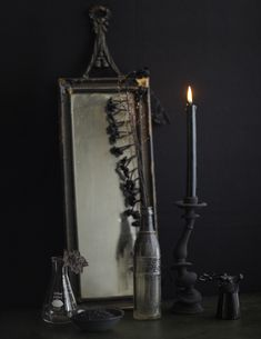 By painting some objects in a flat paint they become all of a sudden really spooky.  The candlestick is painted, www.momastore.org and the bottle has dripping paint on the inside.  Photo by Linda Pugliese