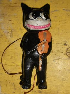 Celluloid Felix the cat John wants to learn how to play the violin.