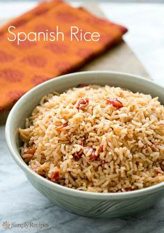 Spanish Rice on SimplyRecipes.com Mom's favorite. Sauté raw rice with onions, then combine with stock & tomatoes to cook. #glutenfree #Mexican #TexMex