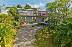 Great family home and value for money in Browns Bay NZ. 4 bedrooms, 1 bathroom and 2 living with 2 carports.