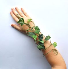 My latest design here I have made another poison ivy accessory, tree people geen woman or green man fancy dress long arm slave bracelet cuff. Any