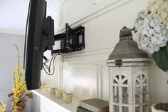 Seriously inspirational hide-the-cords wall mount where the cords can easily be accessed and replaced later. Brilliant and GORGEOUS. Click through for the full tutorial. Tv Mounted Above Fireplace, Tv Over Fireplace, Brick Fireplace Makeover, Wall Mounted Tv, Fireplace Ideas, Mantle Ideas, Fireplace Remodel, Hide Tv Cords, Hide Cables