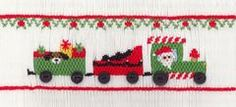 Smocking plate with a Christmas train. 7 rows of smocking on a yoke.